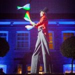 led glow juggler on stilts