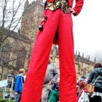 red & gold stilt walker