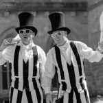 stripey jugglers on stilts