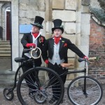 dickensian entertainers with penny farthings