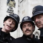 entertainers performing as victorian themed policemen