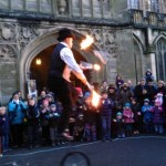 fire juggler on unicycle