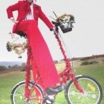 stilt walker on christmas stilts bicycle