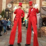 christmas-stilt-walkers-red