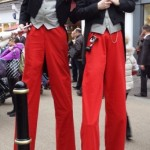 dickensian entertainers on stilts