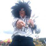 disco afro stilt walker