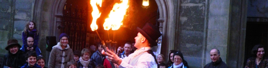 fire juggler performing a show