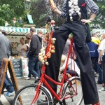 french themed stilt walker