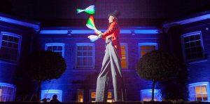 circus themed stilt walking juggler