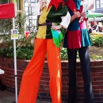 juggling jesters on stilts