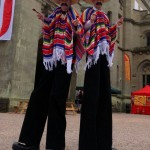 mexican themed stilt walkers
