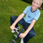 child on mini bike at circus skills workshop