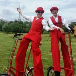 stilt walkers on bikes, london