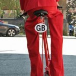 stilt walker riding a bicycle