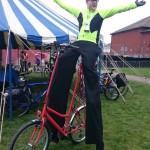stilt walker on a bike, london