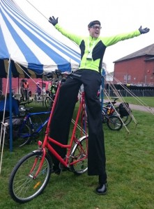 stilt walker on a bike, london