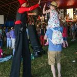 circus skills entertainer dancing on stilts