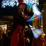 glow juggler on stilts