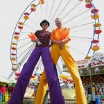 stilt walkers at fair