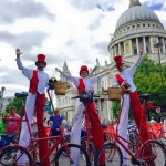 stilt walkers on bikes