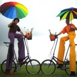 colourful stilt walkers