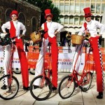 stilt wal;kers on bikes, london