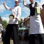french chef and waiter stilt walkers