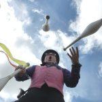 juggling stilt walker at festival