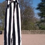stilt walker, stripey costume