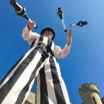 stripey stilt walker juggling