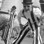 comedy stripey stilt walkers