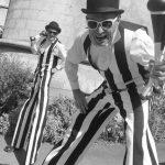 double act, stripey stilt walkers