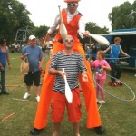stilt walker and juggler