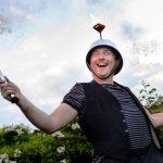 comedy fire juggler